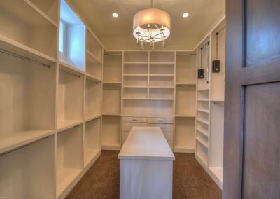 Applehead-Waterfront-Transitional-Closet-by-Zbran…me-Builders1