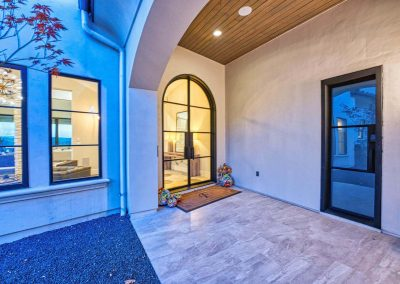 Zbranek-and-Holt-Custom-Homes-Front-Entry-Iron-Front-Door-Stucco