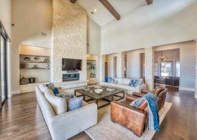 Zbranek-and-Holt-Custom-Homes-Great-Room-Stone-Fireplace-Front-Linear-Fireplace-Stone-Columns