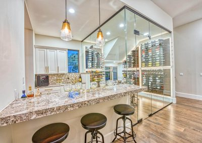 Zbranek-and-Holt-Custom-Homes-Bar-Wine-Room-Backlit-Wine-Racks