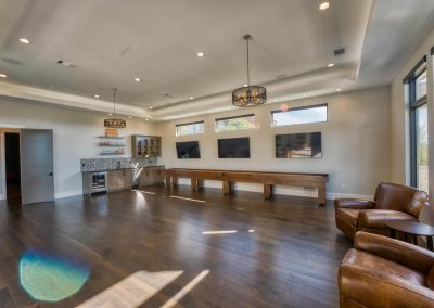 Zbranek-and-Holt-Custom-Homes-Game-Room-Bar-Wood-Floor-TV-Wall