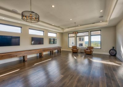 Zbranek-and-Holt-Custom-Homes-Game-Room-Wood-Floor-Shuffle-Board-Table-Contemporary-Lighting
