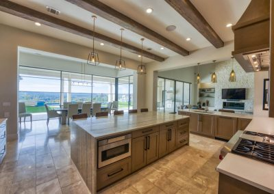 Zbranek-and-Holt-Custom-Homes-Kitchen-Island-Waterfall-Granite-Island-Outdoor-Living