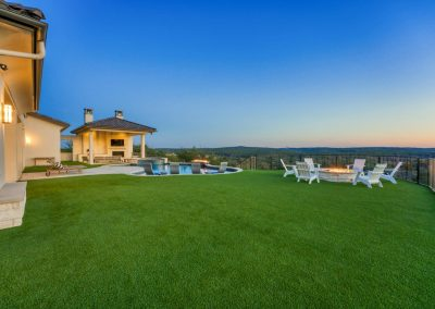 Zbranek-and-Holt-Custom-Homes-Outdoor-Firepit-Outdoor-Cabana-Pizza-Oven-Sunset