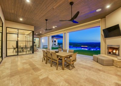 Zbranek-and-Holt-Custom-Homes-Outdoor-Fireplace-Sunset-Outdoor-Living
