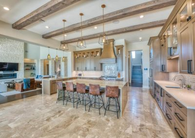 Zbranek-and-Holt-Custom-Homes-Shoe-Sugi-Ban-Beams-Kitchen-Island-Stone-Fireplace