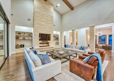 Zbranek-and-Holt-Custom-Homes-Stne-Fireplace-Wood-Floor-Living-Room