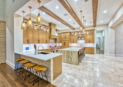 Zbranke-an-Holt-Custom-Homes-Kitchen-Waterfall-Island-Granite-Beams