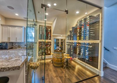 Zbranke-and-Holt-Custom-Homes-Wine-Room-Glass-Door-Wine-Racks-Backlit-Wine-Racks