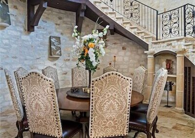 formal-dining-chandelier-horseshoe-bay-texas-tuscan-villa-by-zbranek-and-holt-custom-homes-horseshoe-bay-custom-home-builders