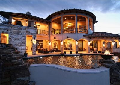 home-of-distinction-austin-showcase-rear-elevation-by-zbranek-and-holt-custom-homes-luxury-home-builders-austin