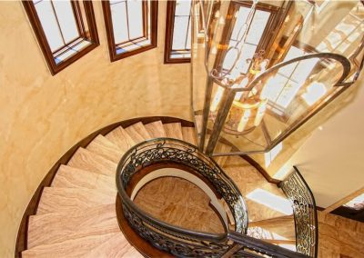 home-of-distinction-austin-showcase-spiral-stairway-by-zbranek-and-holt-custom-homes-luxury-home-builders-austin