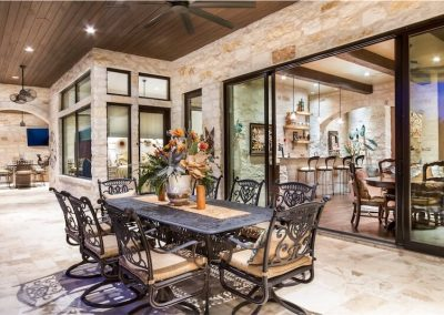 lower-terrace-outdoor-dining-horseshoe-bay-texas-tuscan-villa-by-zbranek-and-holt-custom-homes-horseshoe-bay-custom-home-builders