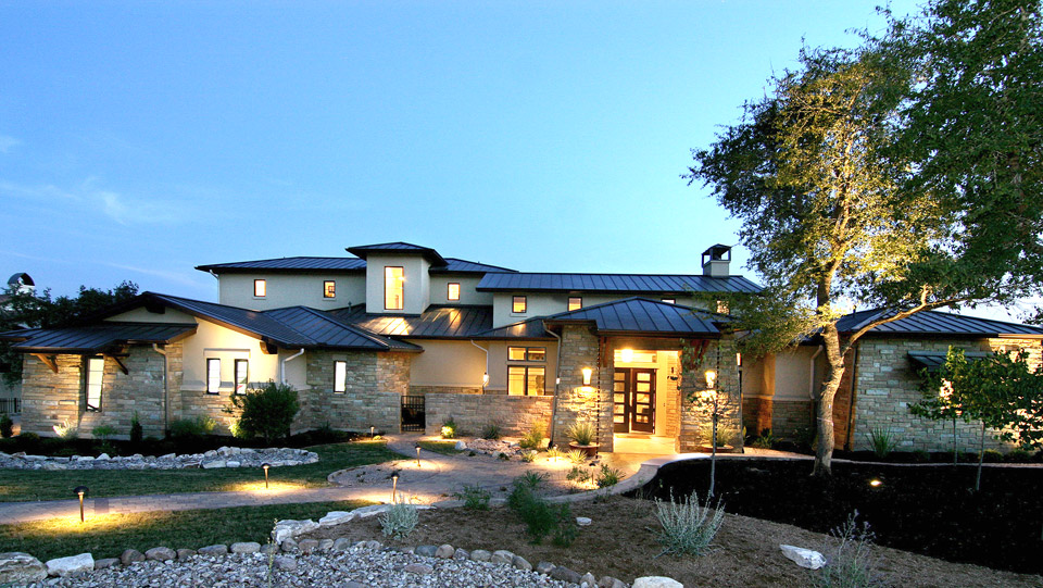 modern custom home in Dripping Springs TX at dusk