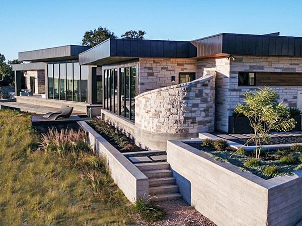 Hill Country Contemporary –  Exterior Rear Right by Zbranek and Holt Custom Homes Luxury Home Builders Horseshoe Bay
