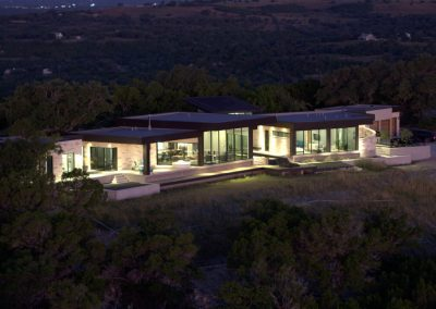 Drone Rear Hill Country Contemporary – Casa Tre Cortili by-zbranek-and-holt-custom-homes-luxury-home-builders-austin