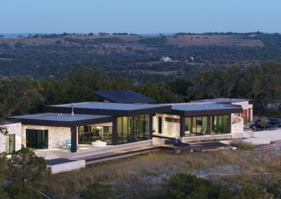 Drone Rear Left Dusk Hill Country Contemporary – Casa Tre Cortili by-zbranek-and-holt-custom-homes-luxury-home-builders-austin