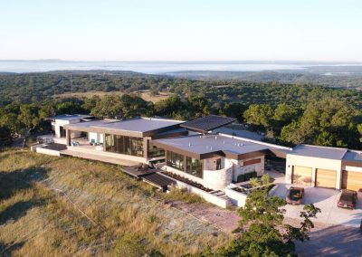 Drone Rear Right Hill Country Contemporary – Casa Tre Cortili by-zbranek-and-holt-custom-homes-luxury-home-builders-austin