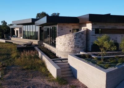 Exterior Rear Right Hill Country Contemporary – Casa Tre Cortili by-zbranek-and-holt-custom-homes-luxury-home-builders-austin