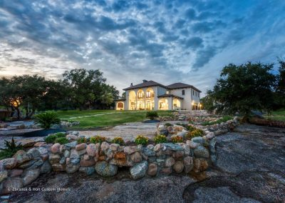 Zbranek-and-Holt-Custom-Homes-European-Lakeside-Exterior-Elevation-Retaining-Planter-Wall