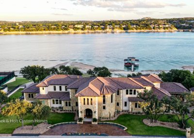 Zbranek-and-Holt-Custom-Homes-Waterfront-European-Luxury-Front-Drone-Lake-View-Day