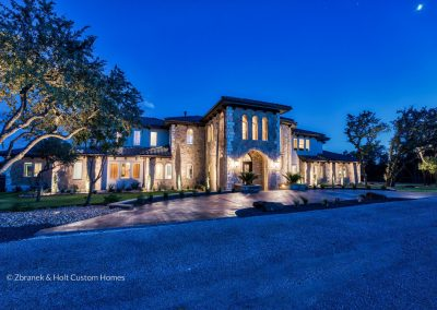 Zbranek-and-Holt-Custom-Homes-Waterfront-European-Luxury-Front-Elevation-Evening
