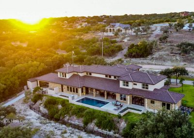 Zbranek-and-Holt-Custom-Homes-Waterfront-European-Luxury-Sunset-Drone-View